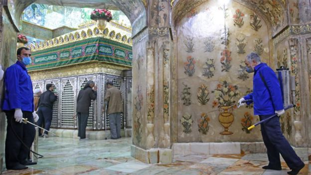 Workers disinfect the Hazrat Masumeh shrine in Qom on 25 February 2020