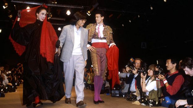 A haute couture dress and a matador's bullfighting uniform by Japanese fashion designer Kenzo Takada during his autumn-winter 1983-1984 fashion show in Paris