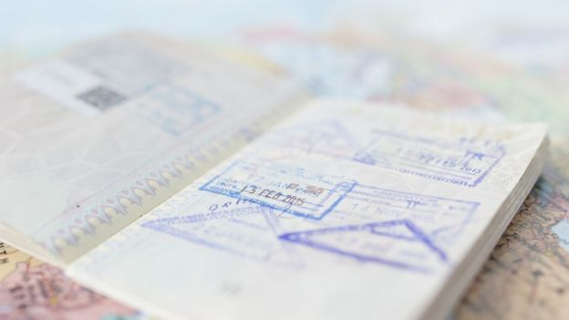 Close up to passport pages with visa stamps and dates