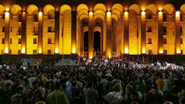 People rally outside the parliament in Tbilisi
