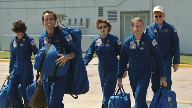 These five astronauts composed the crew for the STS-41-G mission aboard the Space Shuttle Challenger. Leading the way is Astronaut Robert L. Crippen, the crew commander. He's followed by (from left to right), Sally K. Ride, Kathryn D. Sullivan, David C. Leestma, and Jon A. McBridge.