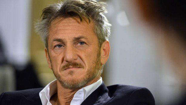 Sean Penn as he looks at someone during a discussion