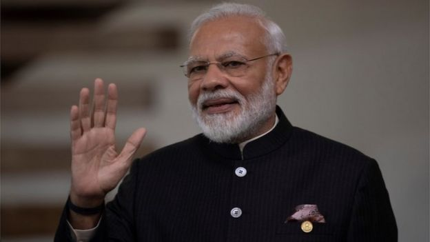 Indian Prime Minister Narendra Modi waving
