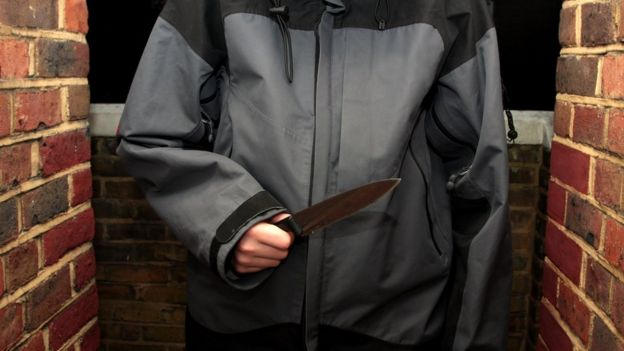 A youth holding a knife