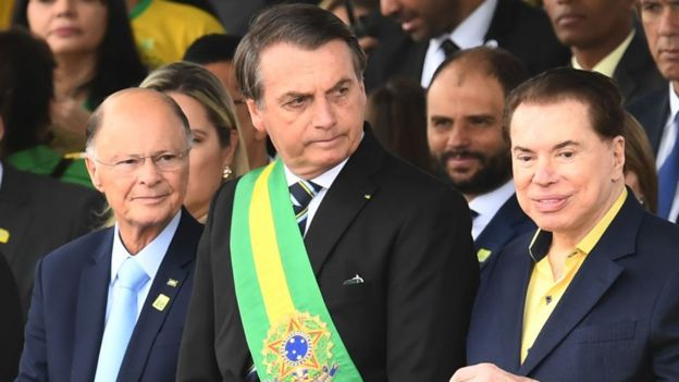 De izquierda a derecha, Edir Macedo, Jair Bolsonaro y Silvio Santos durante el desfile de la independencia.