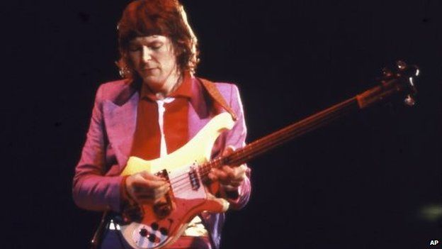 In this circa 1979 photo, Chris Squire plays bass during a Yes concert in Champaign, Illinois