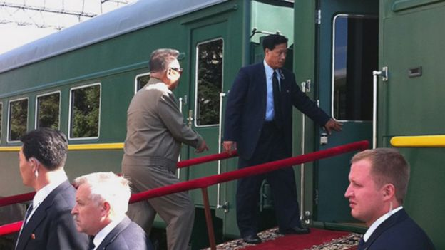 North Korean leader Kim Jong-Il enters his armoured carriage at the station of Novobureisky on August 21, 2011