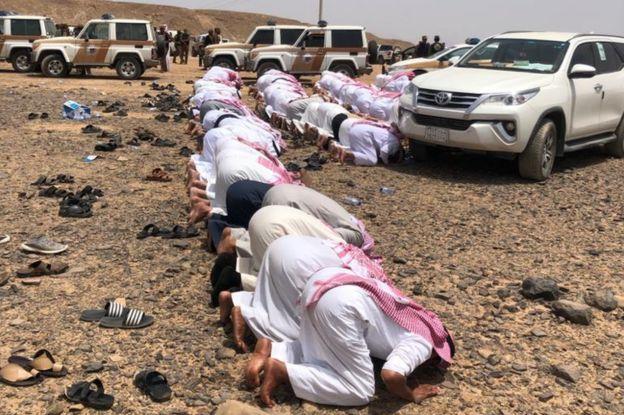 People pray at the funeral of Abdul Rahim al-Huwaiti in Saudi Arabia on 22 April 2020