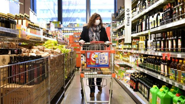 Customers wearing protective face masks shop at supermarket in Vienna, Austria on 1 April 2020