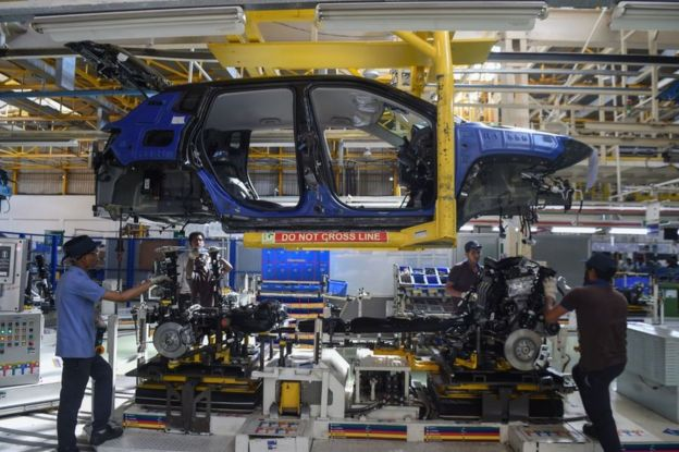 Workers assemble a car at a FCA India Automobiles manufacturing facility in Ranjangaon, some 200km east of Mumbai.