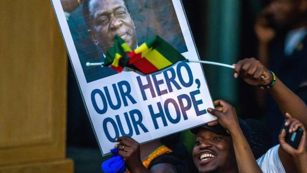 """Supporters of Emmerson Mnangagwa in Zimbabwe hold a banner, saying """"Our hero, our hope"""" - Harare, 22 November 2017"""