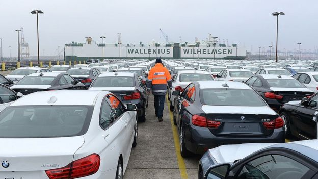 BMW cars waiting to be loaded onto a ship