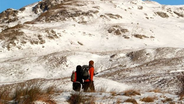 Hill walkers up the mountain Ben Lawers in Perthshire