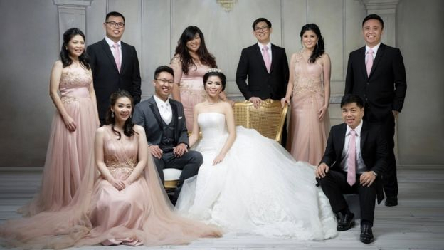 A family wearing rose gold-themed wedding outfits