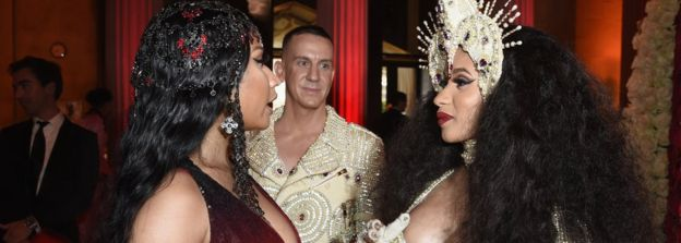 Nicki Minaj and Cardi B speak at the Met Gala in May 2018