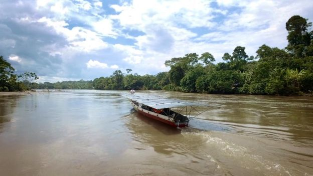 The solar canoe cruising the wide rivers in Achuar territory