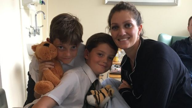 Carly in hospital with her sons Ronnie and Harry