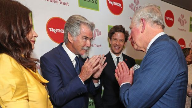 "Prince of Wales greeting Pierce Brosnan (centre) with a Namaste gesture as he arrives at the annual Prince""s Trust Awards 2020 held at the London Palladium"