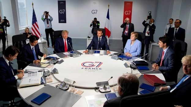 Leaders gather around a table at the G7 summit in France in 2019