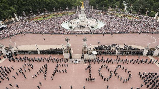 RAF personnel and crowds outside Buckingham Palace