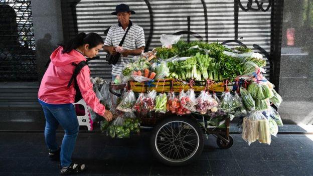 Imagem de vendedor de flores na Tailândia