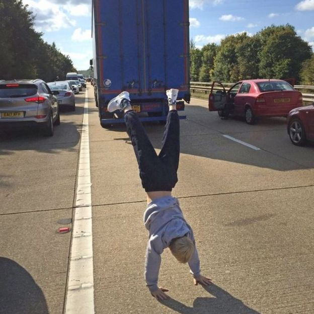 Someone doing a handstand on the M3
