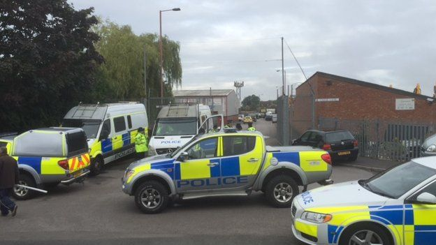 Police vehicles at the community centre
