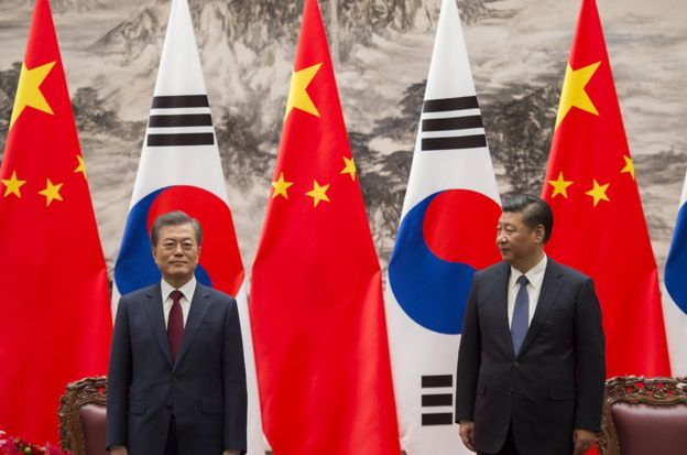 South Korean President Moon Jae-In (L) and Chinese President Xi Jinping (R) stand together at the end of a signing ceremony at the Great Hall of the People on December 14, 2017 in Beijing, China. (Photo by Nicolas Asfouri-Pool/Getty Images)