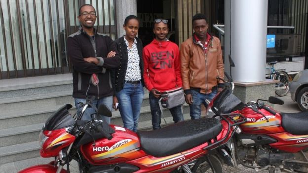 Feleg Tsegaye (left) and some of his Deliver Addis team