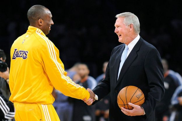 Kobe Bryant shaking hands with Jerry West