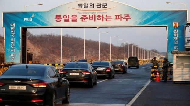 Vehicles with South Korea's delegation drive past a checkpoint on the Grand Unification Bridge that leads to the truce village of Panmunjom.