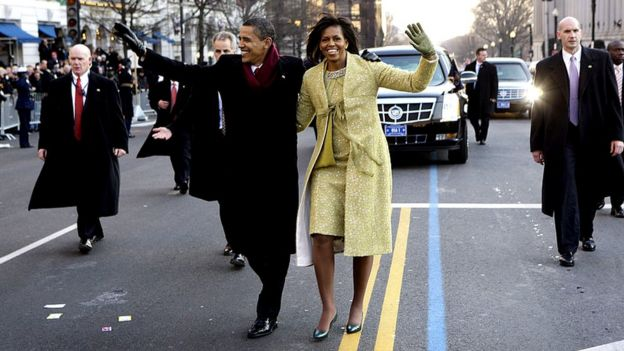 Michelle and Barack Obama walking through Washington DC at his inauguration in 2009