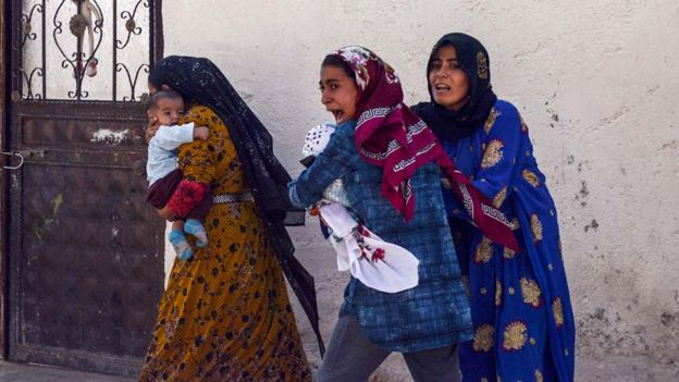 Women run out of their home after a rocket fired from Syria landed in their neighbourhood in the Turkish border town of Akcakale in Sanliurfa province, Turkey, October 10, 2019