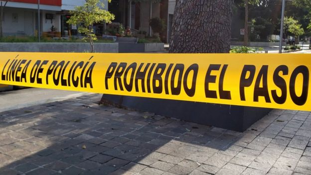 Police tape can be seen in strung across a street in central Guadalajara