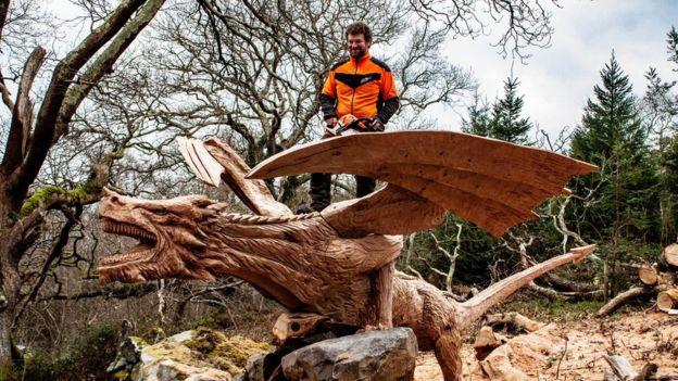 Simon O'Rourke carving the fallen tree