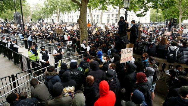 Demonstrators and police in Whitehall