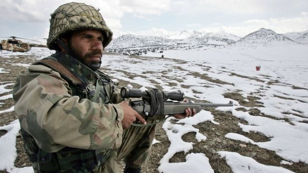 A Pakistani soldier stands guard on the Pakistan-Afghan border