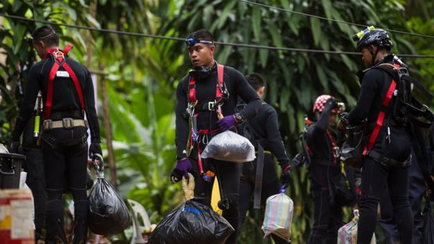 Thai divers carry supplies as rescue operations continue for 12 boys