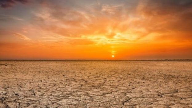 Sunset on a land affected by drought