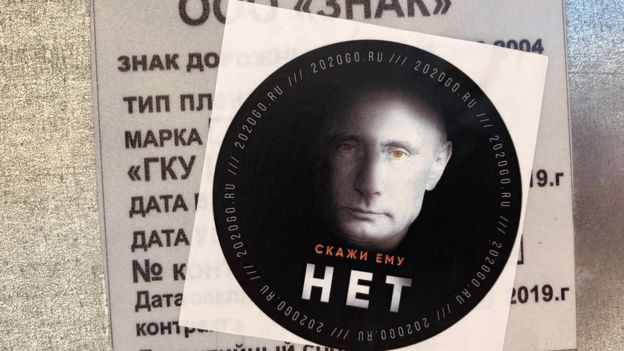 "This anti-Putin sticker reads ""Tell him NO"""