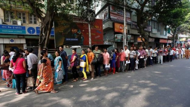 People stand in line as they wait to enter a bank in Kolkata, India, November 10, 2016