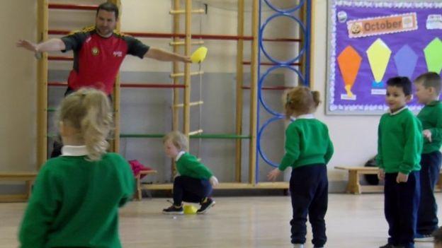 Primary school pupils doing PE