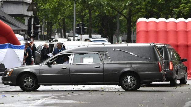 Hearses are parked near a police tent at the scene where a gunman shot dead two police officers and a bystander in the eastern Belgian city of Liege, 29 May 2018