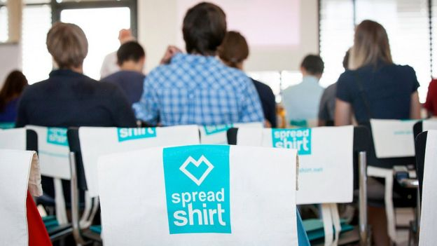 Spreadshirt T-shirts on chairs