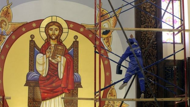 A worker helps finish the new Cathedral of Nativity outside Cairo in Egypt