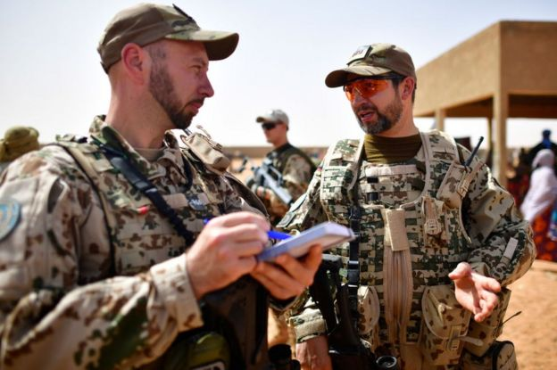 Soldiers of the Bundeswehr, the German Armed Forces gathering information about cattle prices on the outskirts of Gao, Mali on March 7, 2017