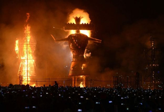 Hindu devotees watch an effigy of the demon king, Ravana, stuffed with firecrackers, burning in Amritsar on 19 October 2018 on the occasion of the Hindu festival of Dussehra.