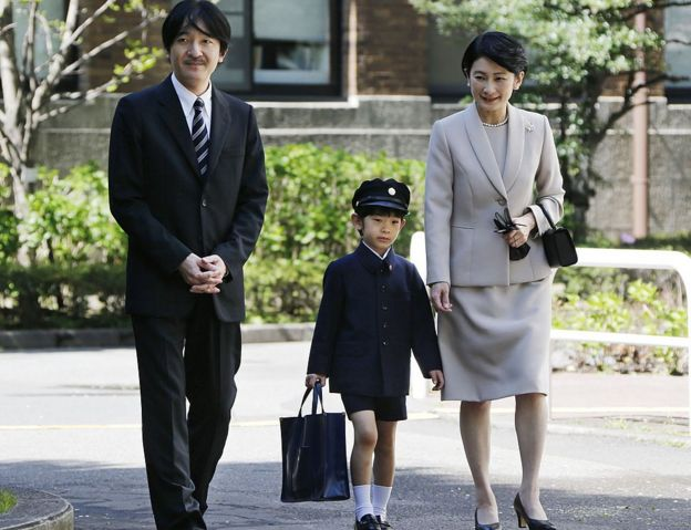 Prince Hisahito (C) accompanied by his parents Prince Akishino (L) and Princess Kiko, arrive at Ochanomizu University Elementary School for his entrance ceremony in Tokyo on 7 April 2013