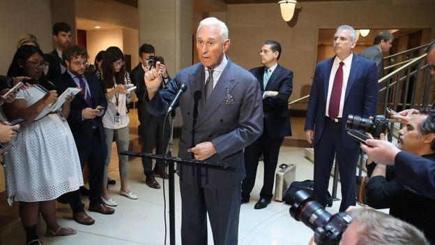 Roger Stone talks to the press after testifying before Congress.