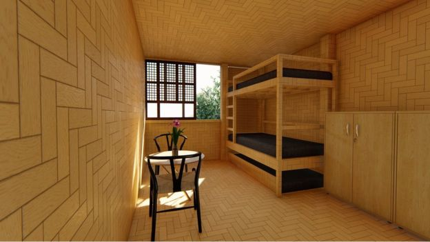 A bedroom featuring bunk beds, a table with chairs, and a tessellating tiling pattern on the bamboo walls